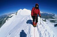 Woman climbing the summit ridge of Castor Valais Italy