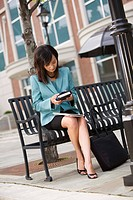 Businesswoman sitting on bench