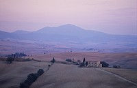 Typical landscape of Crete at dusk Tuscany Italy