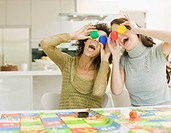 Women having fun with board game