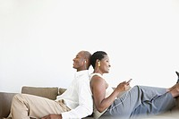 Couple relaxing with music at home