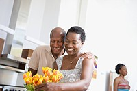 Couple enjoying fresh flowers at home