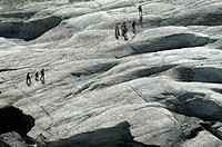 Walkers on the glacier Pasterze, national park Hohe Tauern, Austria