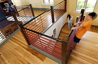 Children playing on contemporary wooden staircase