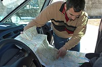 Mr Motorist studying road map before the drive