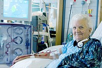 Kidney dialysis. Patient in a dialysis treatment unit. Kidney dialysis, or haemodialysis, is required when the kidneys are no longer able to filter wa...