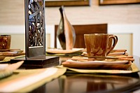 Place settings with mugs on dining room table