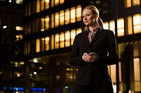 Businesswoman outside an illuminated building