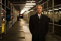 Businessman standing in a walkway
