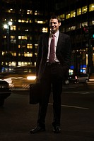 Businessman standing in the road