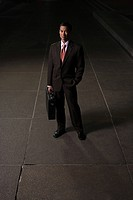 Japanese businessman on a sidewalk at night