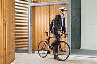 Man riding bicycle (thumbnail)