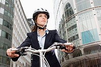 Woman cycling in city (thumbnail)