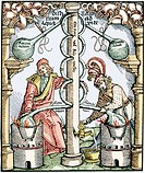 Distillation. Coloured 16th century woodcut depicting apparatus used for distillation. Two liquids to be distilled are being heated in large flasks bo...