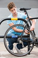 Man locking bicycle