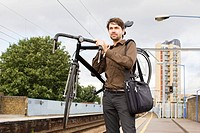 Man with bike at train station
