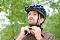 Man wearing bicycle helmet