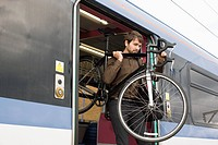 Man with bike on train