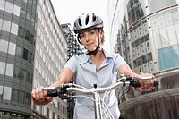 Woman cycling in city