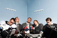 Exhausted businessmen in changing room