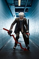 Businessman wearing an ice hockey uniform (thumbnail)