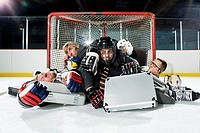 Five businessmen playing ice hockey
