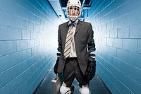 Businessman wearing an ice hockey helmet