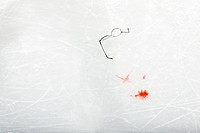 Eyeglasses and blood on the ice