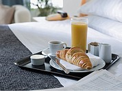Breakfast tray on a hotel bed