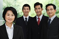 Four chinese businesspeople