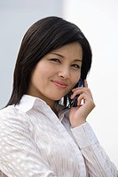 Businesswoman using a cellular telephone (thumbnail)