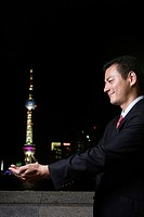 Businessman holding the oriental pearl tower