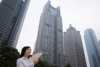 Chinese woman near skyscrapers