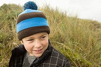 Boy wearing bobble hat