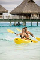 Couple in canoe in bora bora