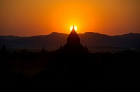 Sundown over the tip of a stupa Bagan Burma