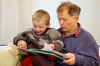 Father reading to his little five year old boy a picture book picture-book