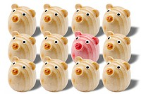 Group of wooden toy pigs
