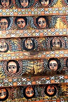 Ethiopian Orthodox Christianity old colourful roof painting of angel heads with wings Trinity church Debre Berhan Selassie Gondar Ethiopia
