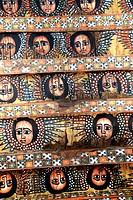 Ethiopian Orthodox Christianity old colourful roof painting of angel heads with wings Trinity church Debre Berhan Selassie Gondar Ethiopia