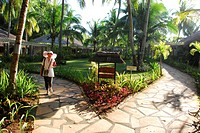 A tourist walking in the garden of a resort, Bohol, Philippines