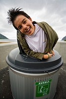 Teen appearing from rubbish containers, Norway