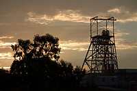 Silhouetted view of a mine shaft tower at dusk, Johannesburg, Gauteng Province, South Africa