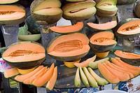 A hami_melon stand at Erdaoqiao Bazaar, Urumuqi, Xinjiang, China