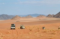 4x4 Vehicles driving through the barren Namib Desert. Sprinkbokvlakte, Namibia, Africa