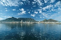 Table Mountain viewed from the sea with white puffy clouds in the sky. Cape Town, Western Province, South Africa