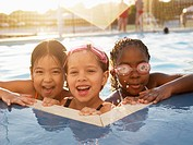 Three girls in swimming pool portrait