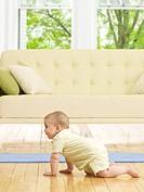 Baby Boy Crawling near Sofa