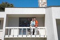 Couple standing on balcony