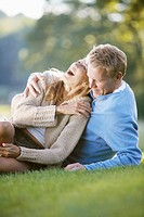 Couple lying on grass and laughing